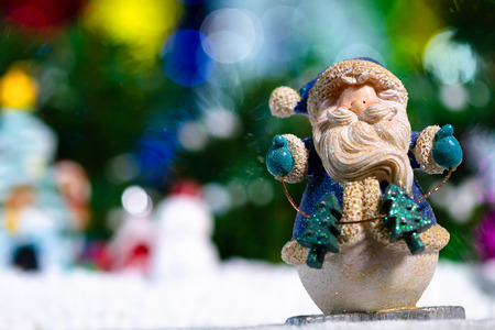 A lovely santa doll standing on blurred beautiful lighting background and copy space Stock Photo