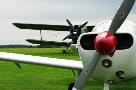 masuria: small aeroplanes standing on a grass, during yearly air meetings, Masuria, Poland