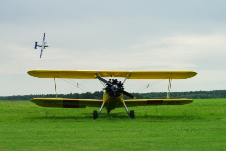monoplane: small airplane standing on a grass during yearly air meetings, Masuria, Poland