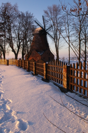 The old windmill in a calm winter landscape photo