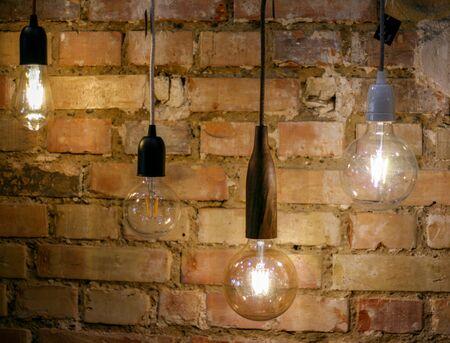 Hanging lamps, light bulbs, modern design, brick wall, art lights artistic