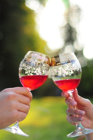 Toasting with red wine in glasses