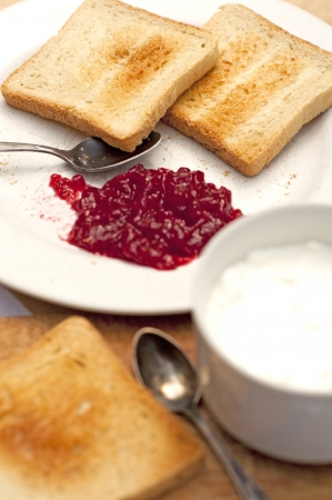 toast with raspberry jam - close up  Stock Photo
