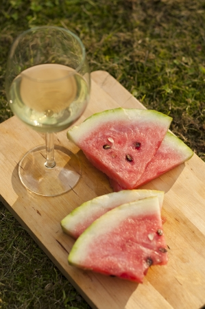 Apple cider and watermelon on the summer picnic  photo