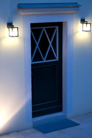 Entrance of a house at dusk photo
