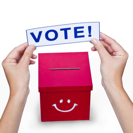 Hands with a voting card Stock Photo - 15818043
