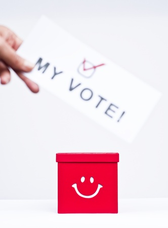 Hand putting a voting ballot in a slot of box  Stock Photo - 15818039