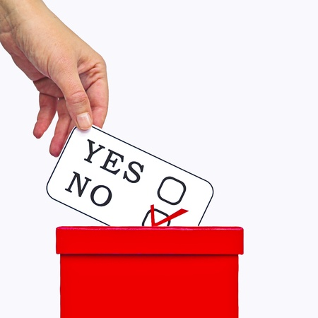 electoral system: Hand putting a voting ballot in a slot of box