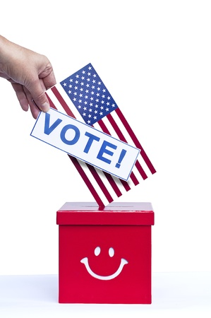Hand putting a flag and a voting card in a slot of box Stock Photo - 15818050
