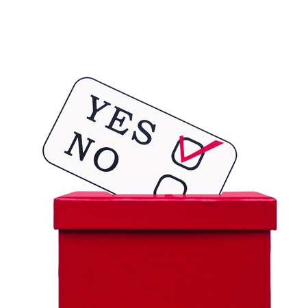 local council election: Voting card  in a slot of election box Stock Photo