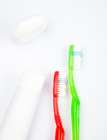 Two colorful toothbrushes, toothpaste and dentalfloss Stock Photo - 18996900