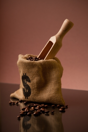Burlap sack of coffee beans with wooden scoop