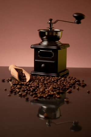 coffee beans, wooden scoop and old coffee mill