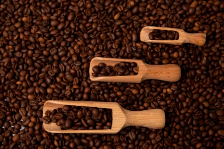 Wooden shovels full of coffee Stock Photo
