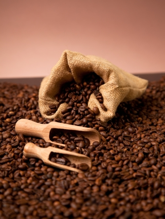 Wooden shovels full of coffee with burlap sack