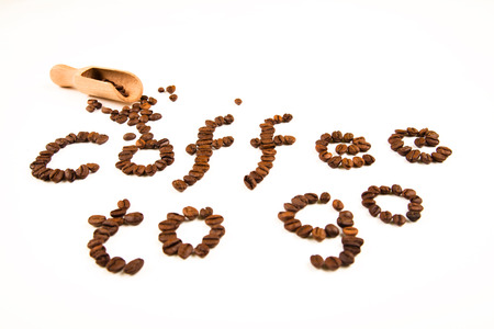 coffee sign made of coffee beans on white background