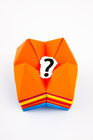 Origami figures with a question mark Stock Photo