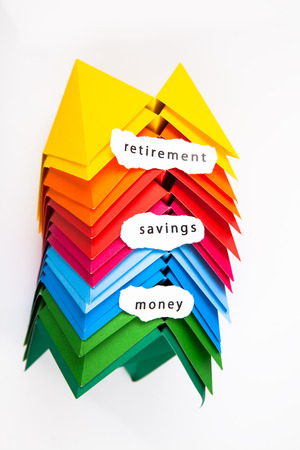 Colourful origami figures with signs money, retirement, savings photo
