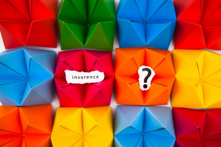 Colourful origami figures with sign insurance photo