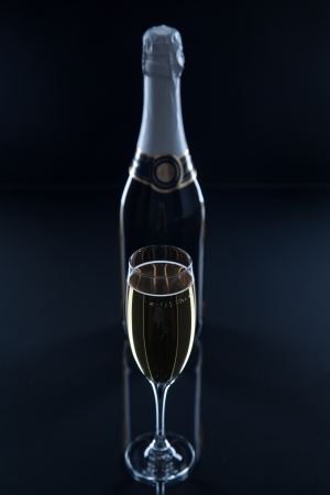 glass and a bottle of champagne