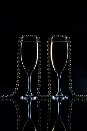 glasses of champagne and golden decoration Stock Photo