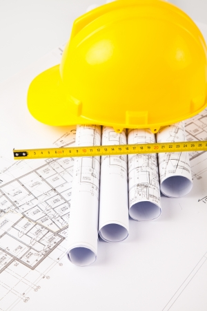 photo of hardhat and measure on blue print  Stock Photo