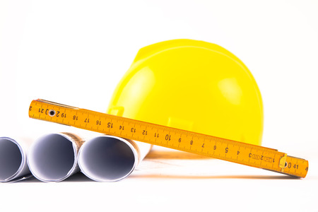 photo of hardhat and measure and rolls photo
