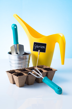 Gardening tools over blue background photo