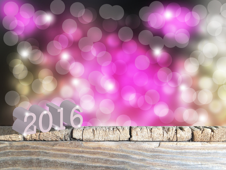 year 3d: 2016 3D on Old  wood table top on color  blurred light abstract background . use  for display or montage your products