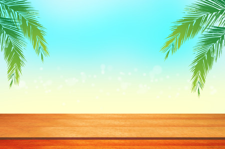coconut leaves: image of Wood table with blur beach and coconut leaves.