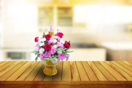 flowers on  wooden table and blurred kitchen background.can be used for montage or display your products.