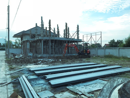 LOPBURI, THAILAND- MAY 24, 2018: The workers work at building site with new homes under construction, LOPBURI, THAILAND.