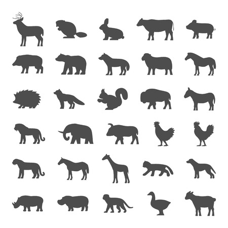 Set of domestic and wild animals. Black silhouettes of animals on a white background. Dog, cat, cow, pig, bear, elephant and other animals.