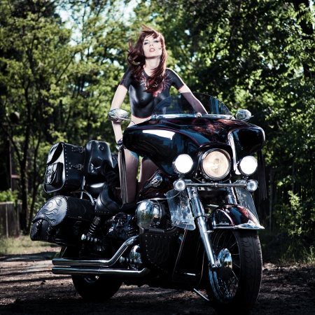 female on a motorcycle  body-art Stock Photo