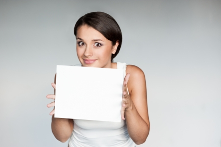 female in casual outfit holding sign photo