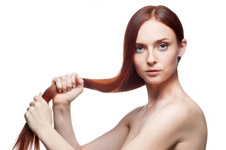 female holding her long gorgeous natural red hair photo