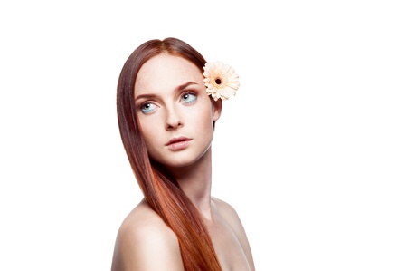 portrait of young red-haired green-eyed female with flower in hair Stock Photo - 15751929