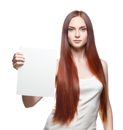 female in casual outfit holding sign Stock Photo