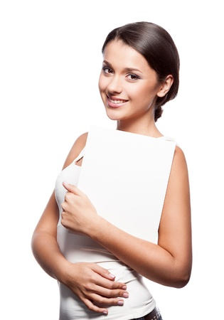 young smiiling casual brunette caucasian girl holding sign Stock Photo