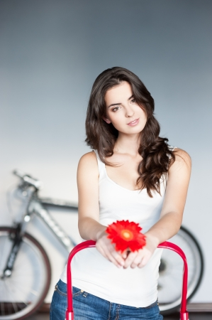 young casual caucasian girl with red flower photo