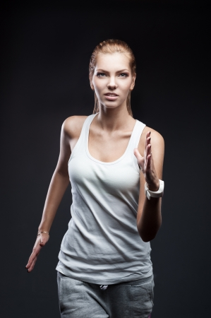 running girl on dark background Stock Photo