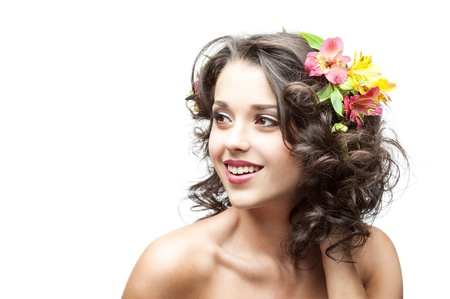 beautiful smiling brunette girl with flowers in hair photo