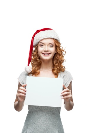 young casual girl in santa hat holding sign Stock Photo - 15784267