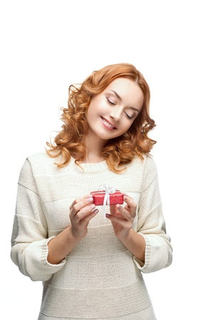 young red-haired happy smiling girl holding gift Stock Photo - 15784276