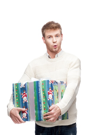 young surprised man holding big heavy gift Stock Photo - 15784278