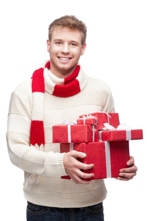 young man holding many red christmas gifts