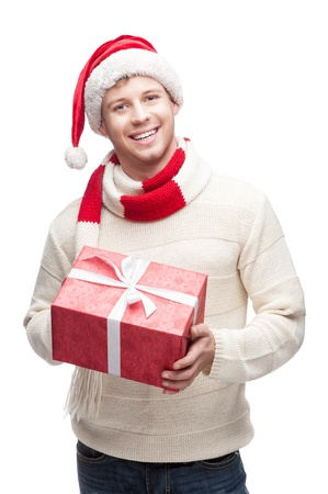 young casual caucasian man holding big red christmas gift with nice toothy smile Stock Photo - 15784282