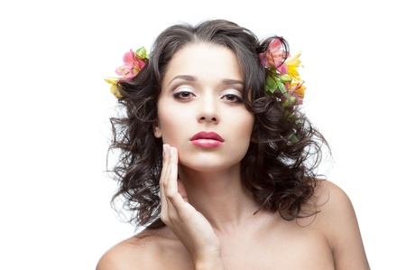 portrait of young attractive caucasian woman with lily flowers in hair photo