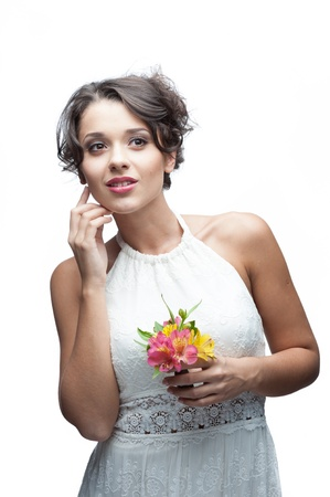 portrait of young attractive caucasian woman with lily flowers photo