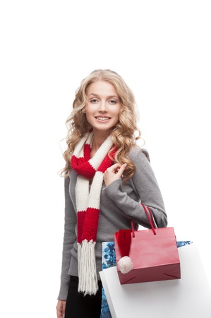 young happy smiling casual  blond woman holding  shopping bags isolated on white Stock Photo - 15971541
